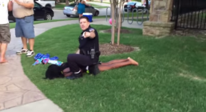 A police officer slamming a black girl to the ground